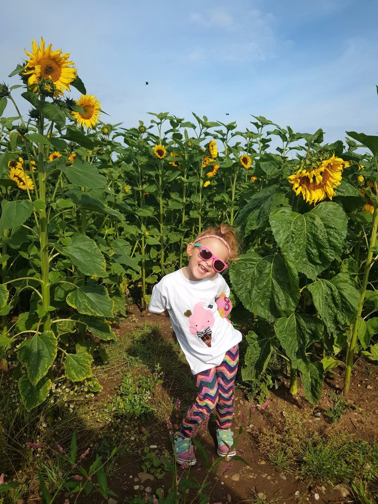 Pretending to stand like a sunflower!!