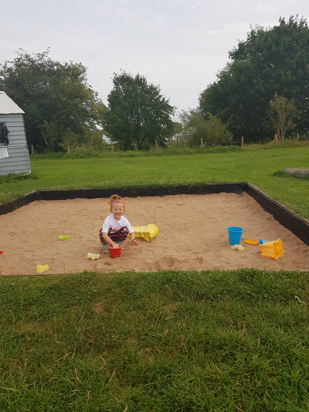 Loving the sandpit at Cattows