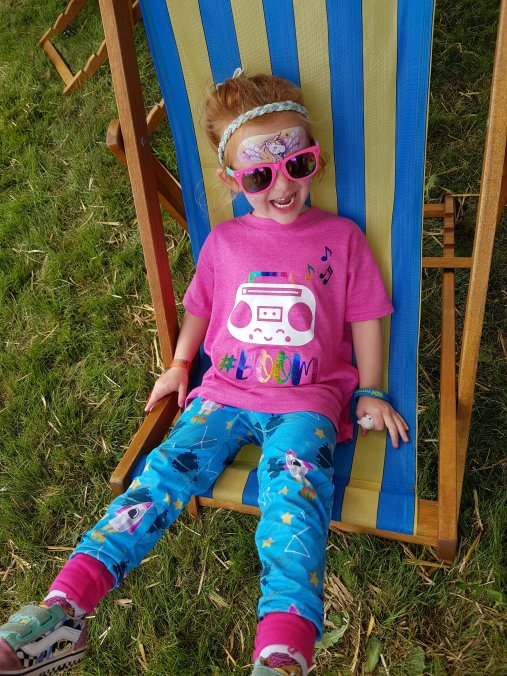 Chilling out on a giant deckchair by the sandpit