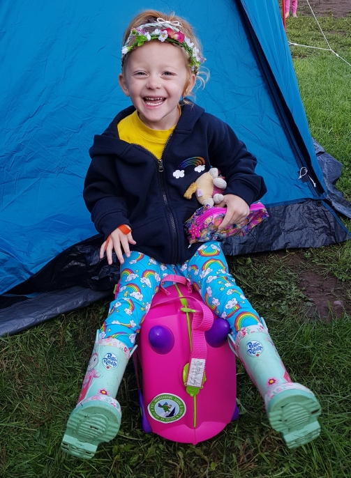 Hanging out at the campsite with her Trunki