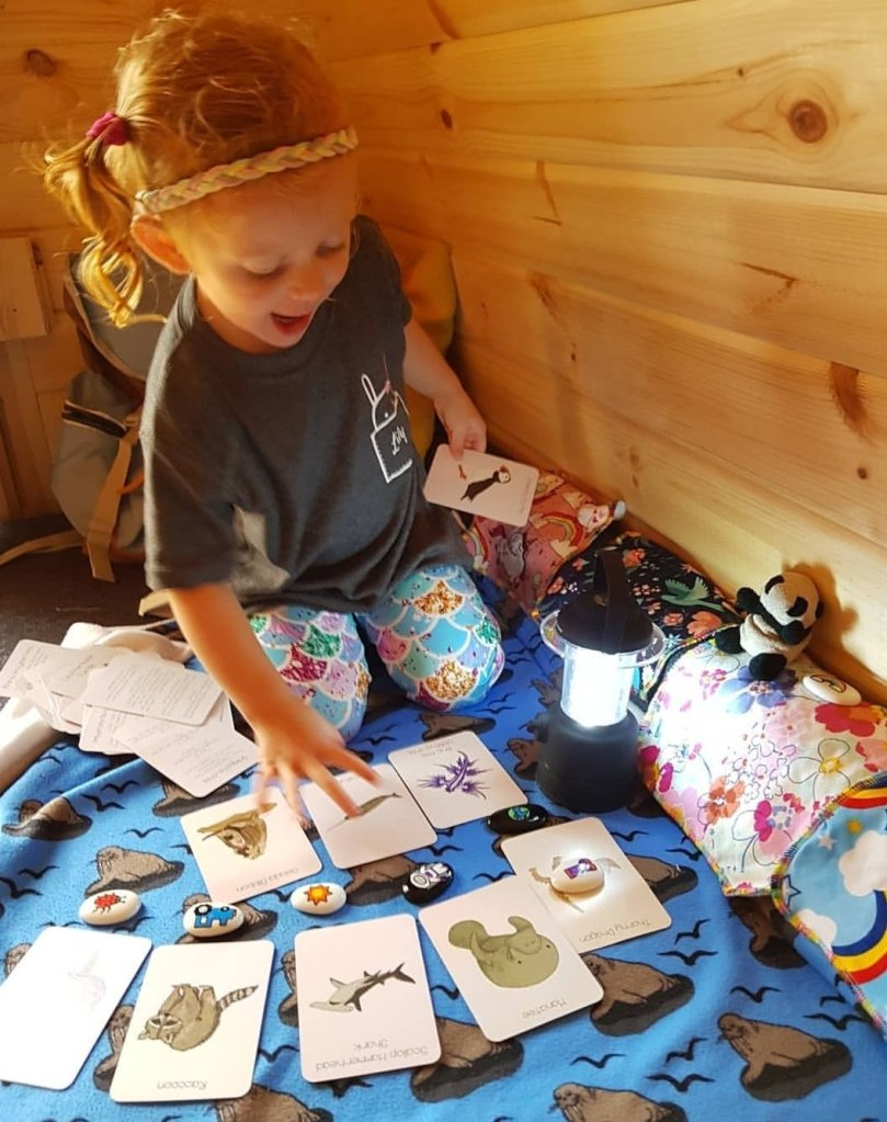 Lily enjoying the Button & Squirt Amazing Animal cards on one of our camping pod trips