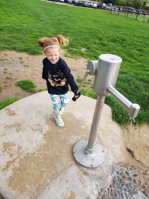 Lily enjoyed the outdoor play area - especially the water pump!