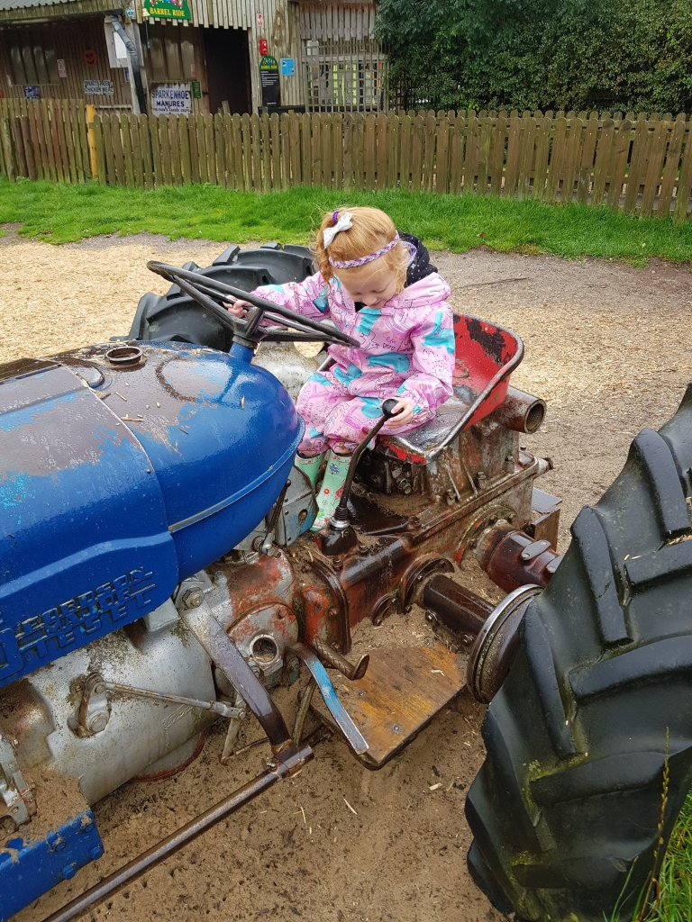 Trying to head off on her own tractor ride...!