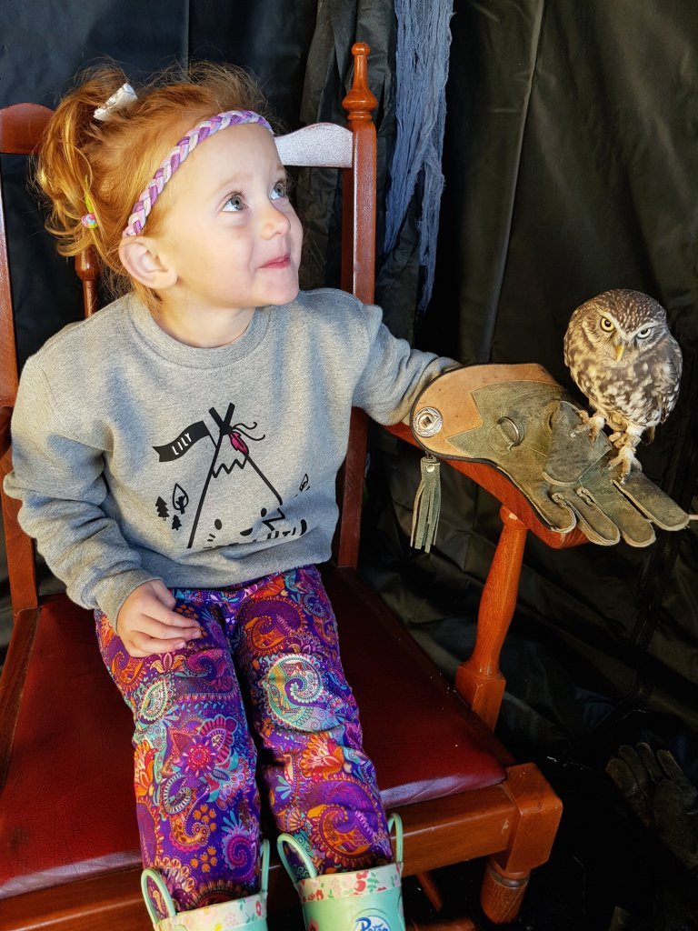 She was so proud of herself for holding the owl!