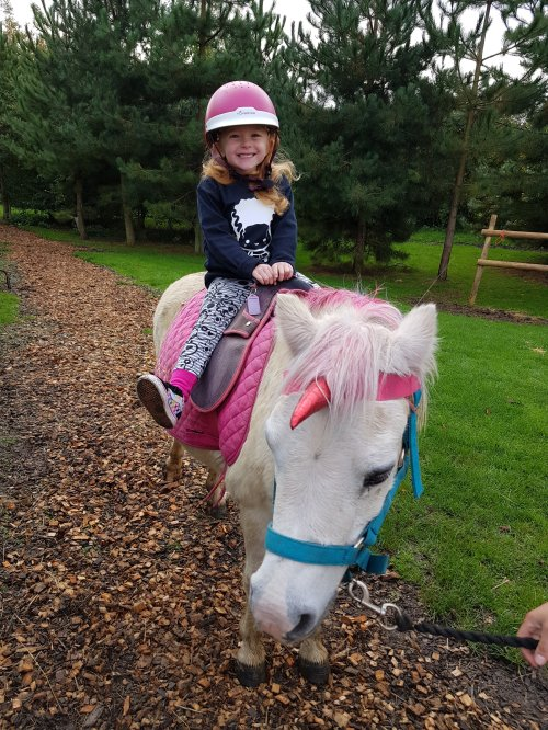Happiness is... riding a real unicorn!