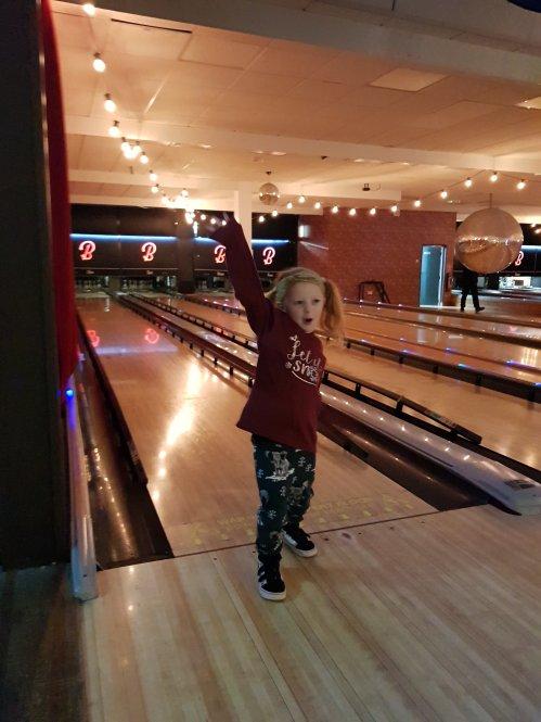 Enjoying beating mummy on her first game bowling!
