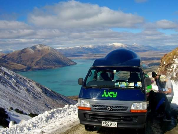 South Island, NZ. An incredible backdrop for attaching snow chains to the camper!