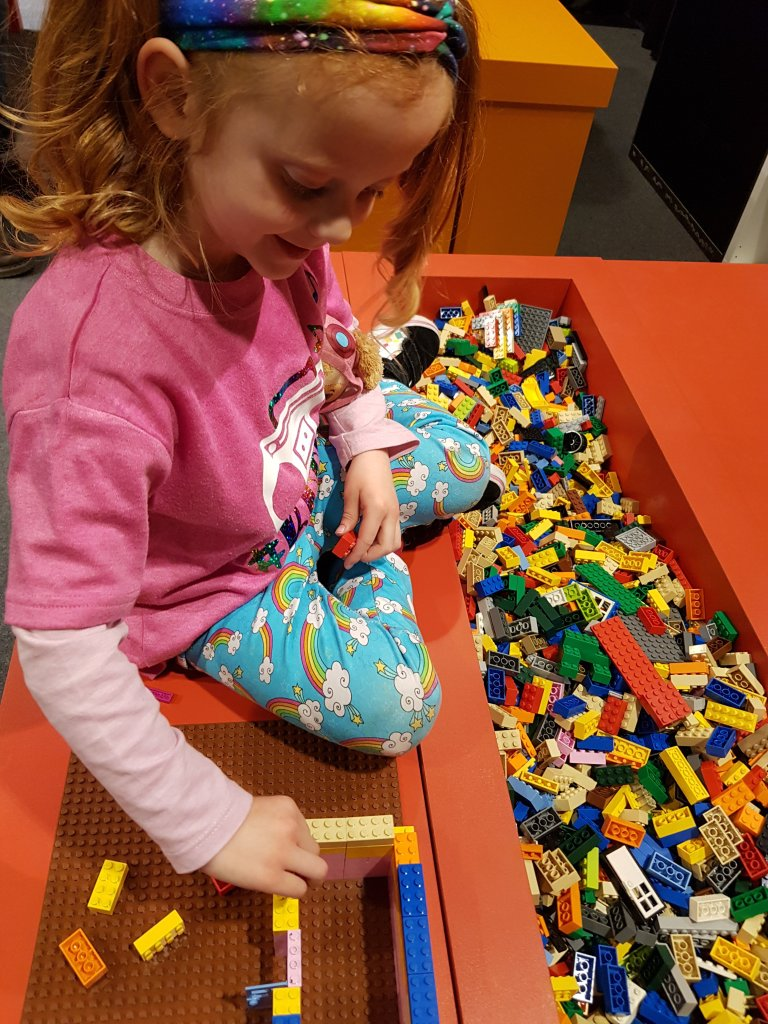 She could spend hours building with LEGO!