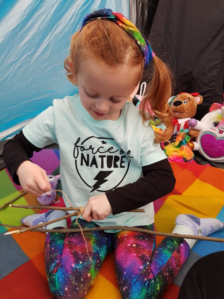 Bringing stick crafts to our tent!