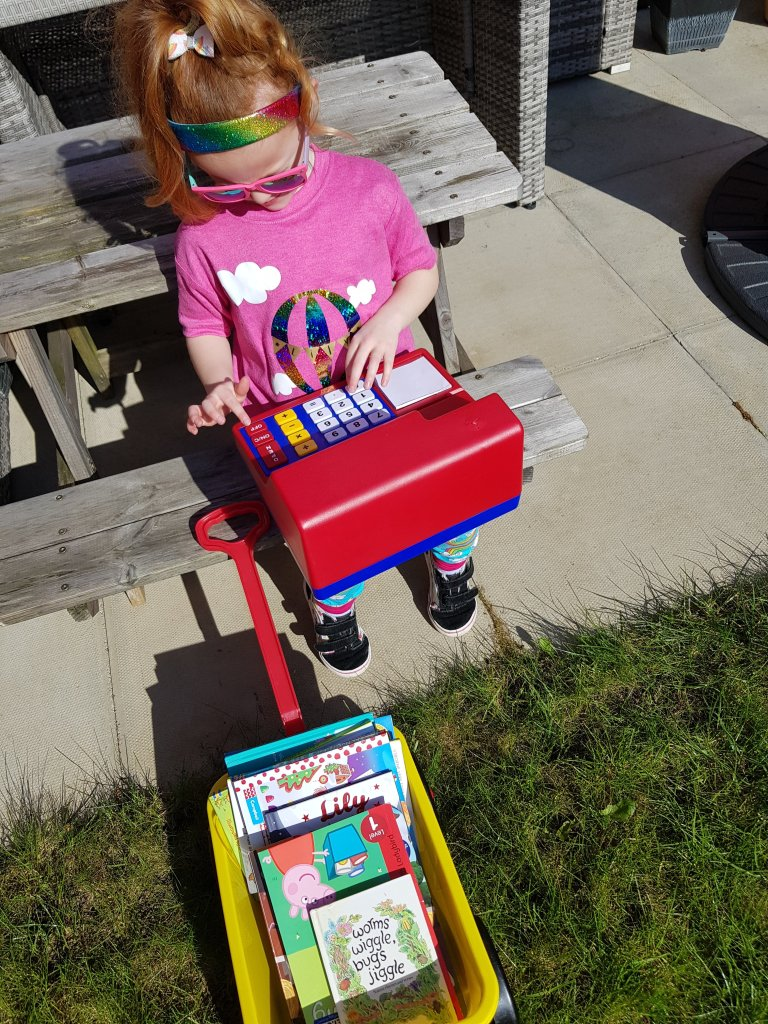 "Her ""mobile library"" and Learning Resources UK till (gifted)"