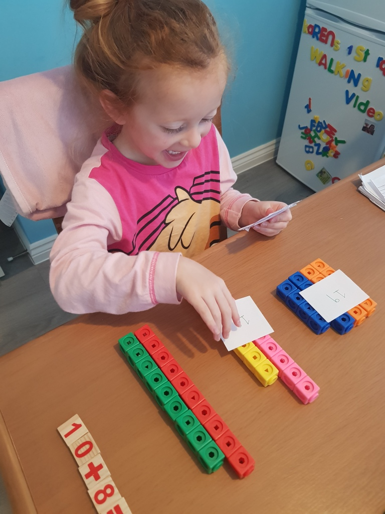 Number matching activities with her Mathlink cubes