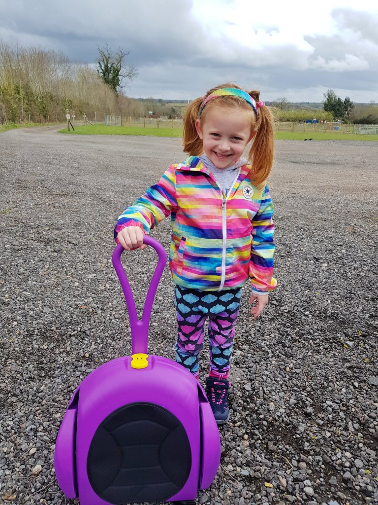 The CarGoSeat turns into a wheeled case for all her things!