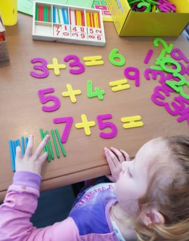 Counting alongside her Tactile Numbers