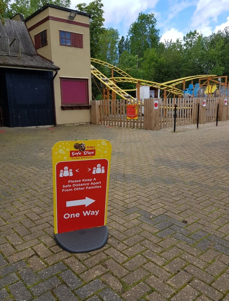 One of the One Way signs and the queuing system for the rollercoaster behind