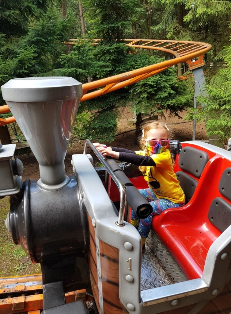 Families are spaced out when going on the rides