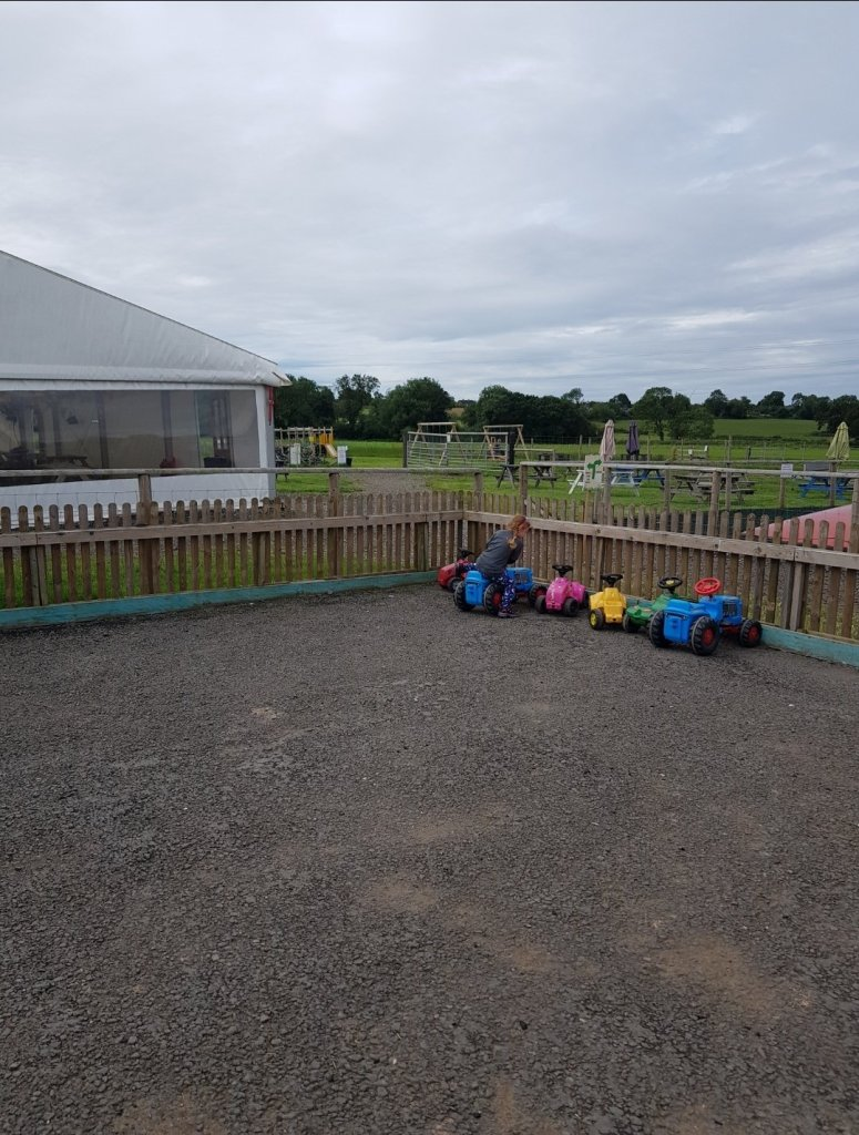 The ride-on area with the marquee behind where you can eat your food, or there are picnic benches around the play area