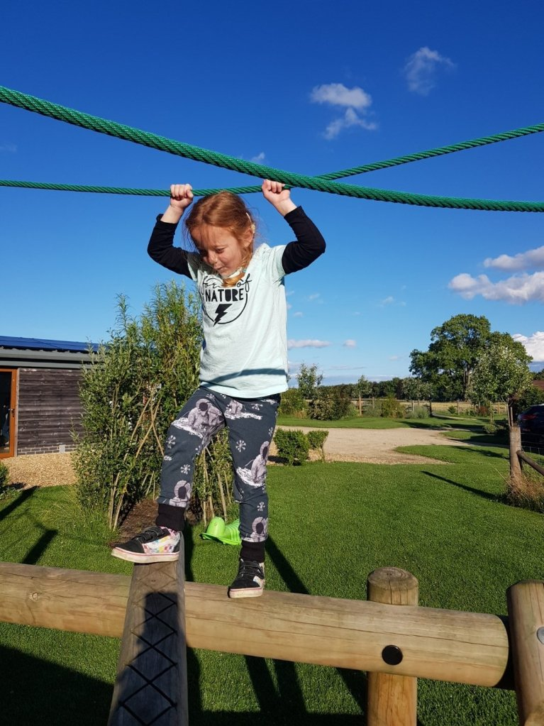 Climbing around the outdoor play area
