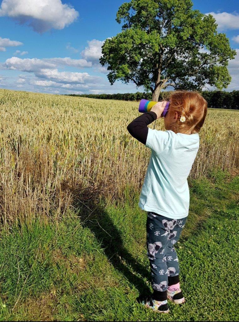 Birdwatching with her Kidnoculars by our Cotswolds camping pod - July 2020