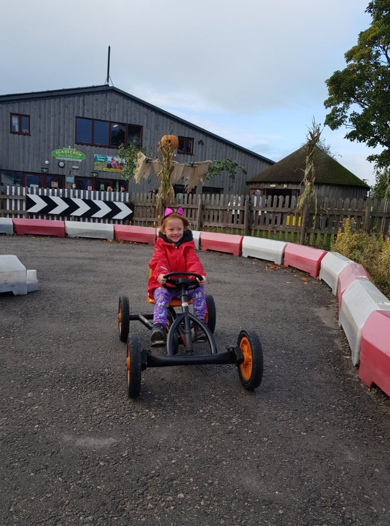 Taking a ride on the gokarts