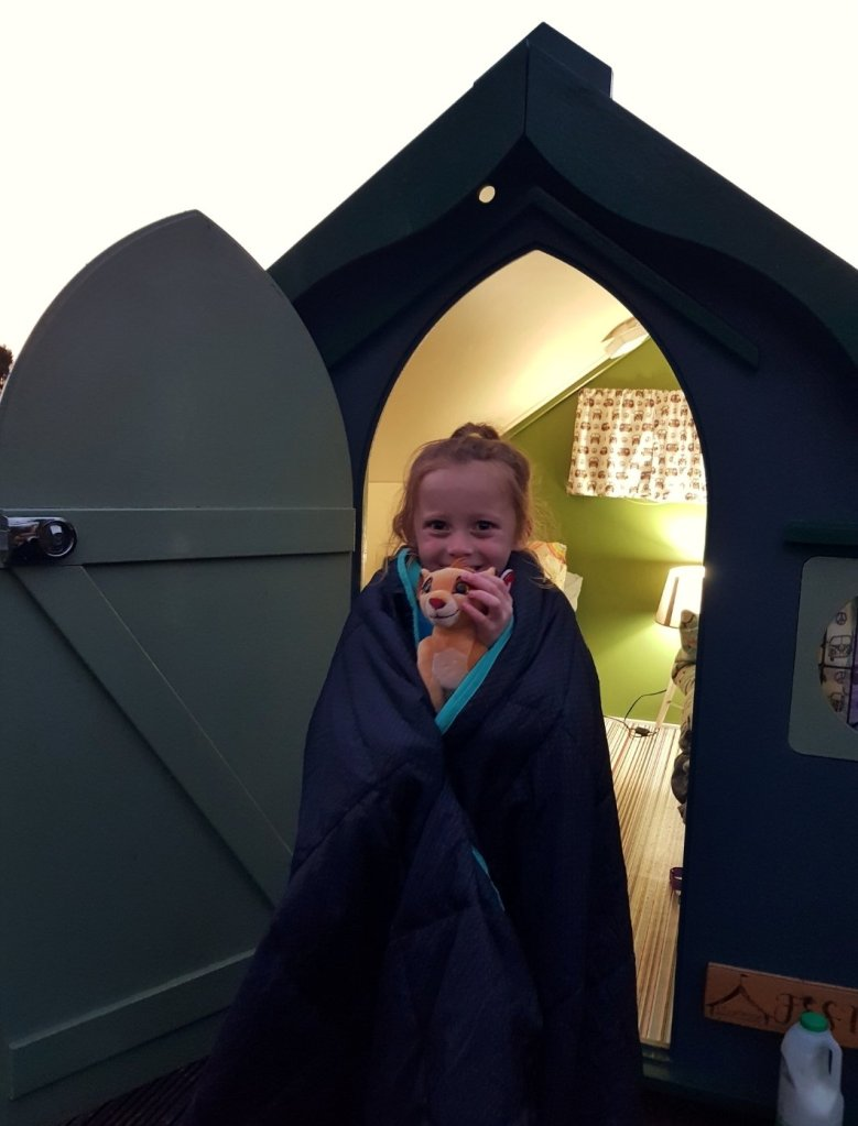 Lily all cosy in our little festival pod