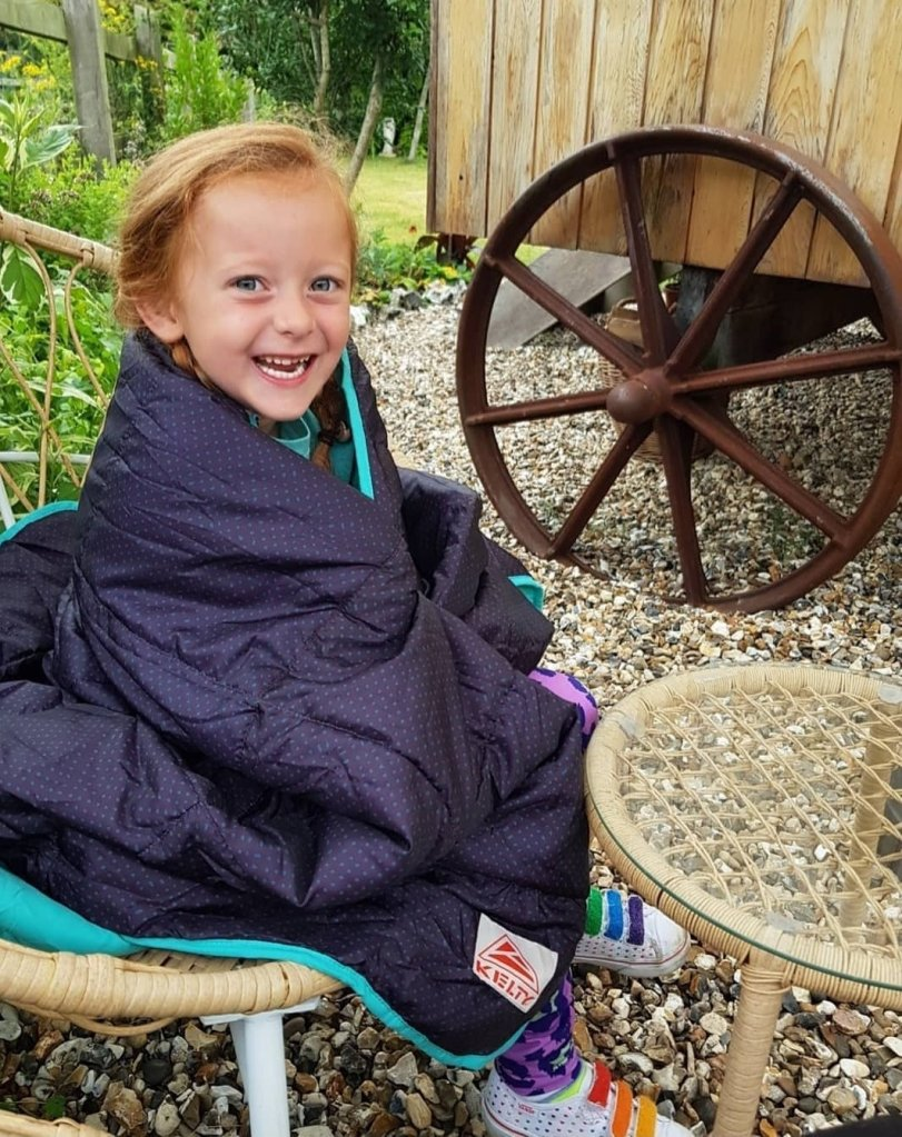 Her Kelty Bestie blanket is now a staple on all our adventures