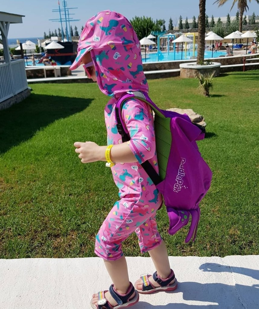 Heading to the pool with her Trunki Paddlepak