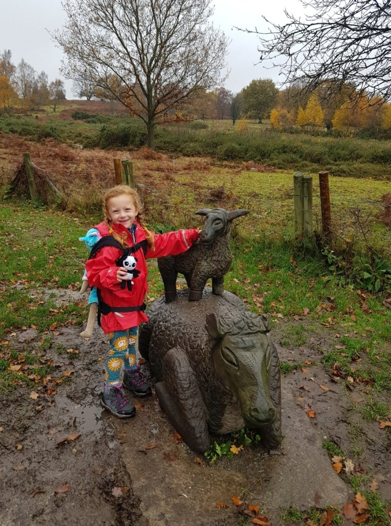 Lily loves the sculptures at Beacon Hill