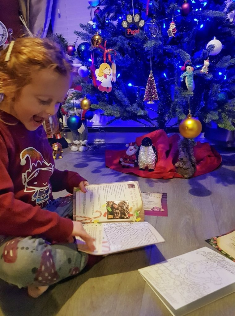Enjoying her Christmas activities - these ones were from LaplandMailroom.com (gifted)