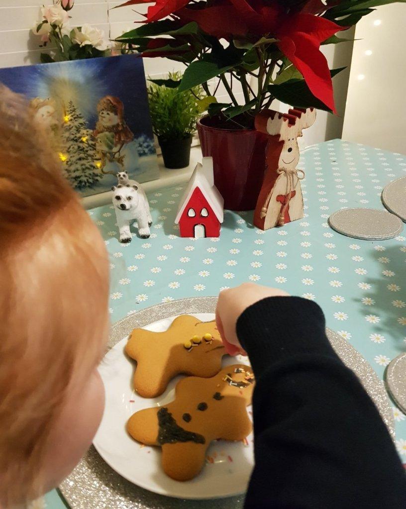 Decorating her gingerbread men!