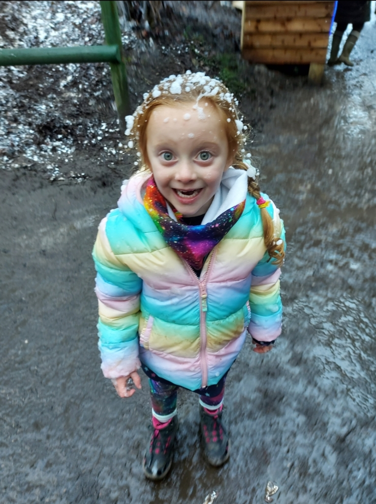 Excited by all the snow in her hair!