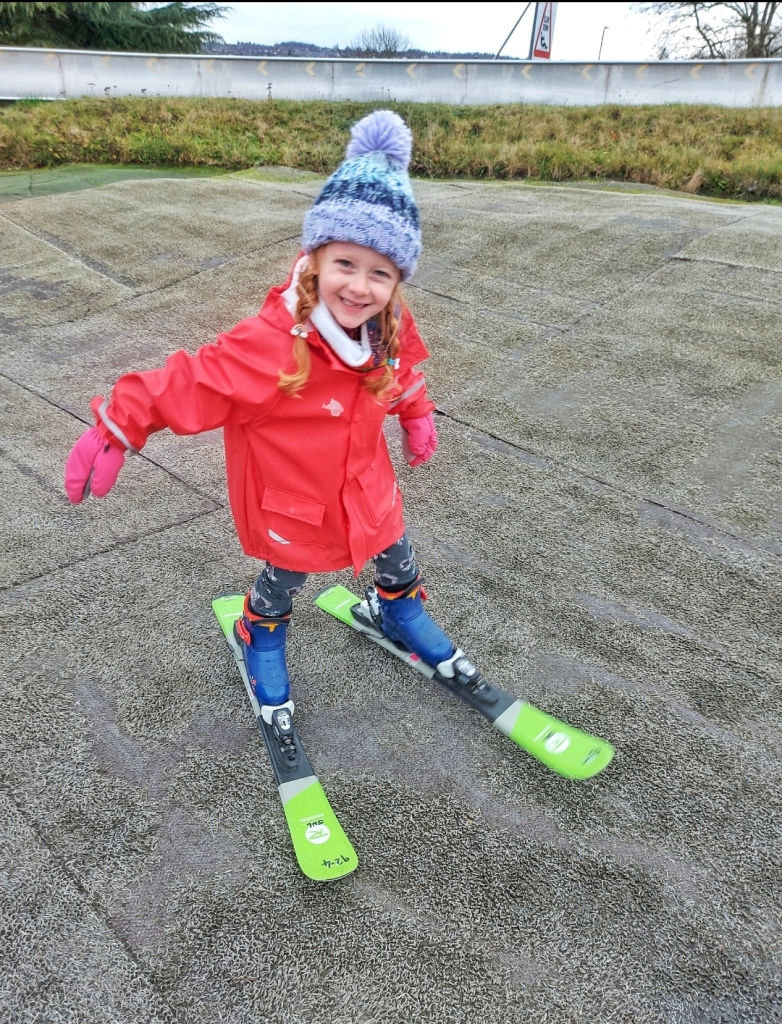 Lily having her ski taster session on the nursery slope