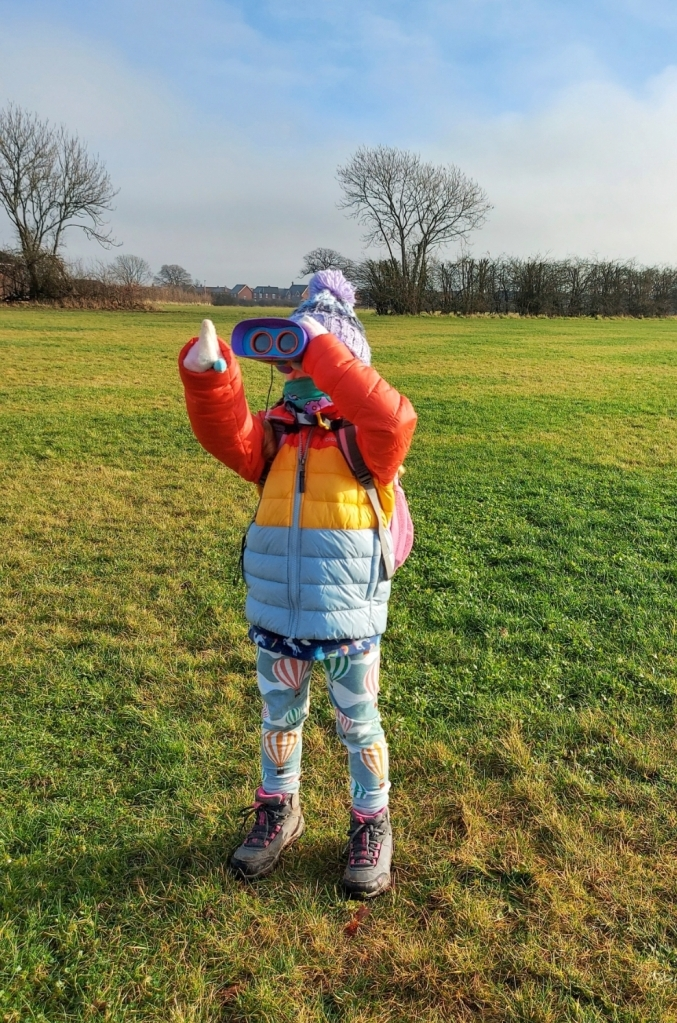 Lily loves her Kidnoculars when visiting the field near our house each day