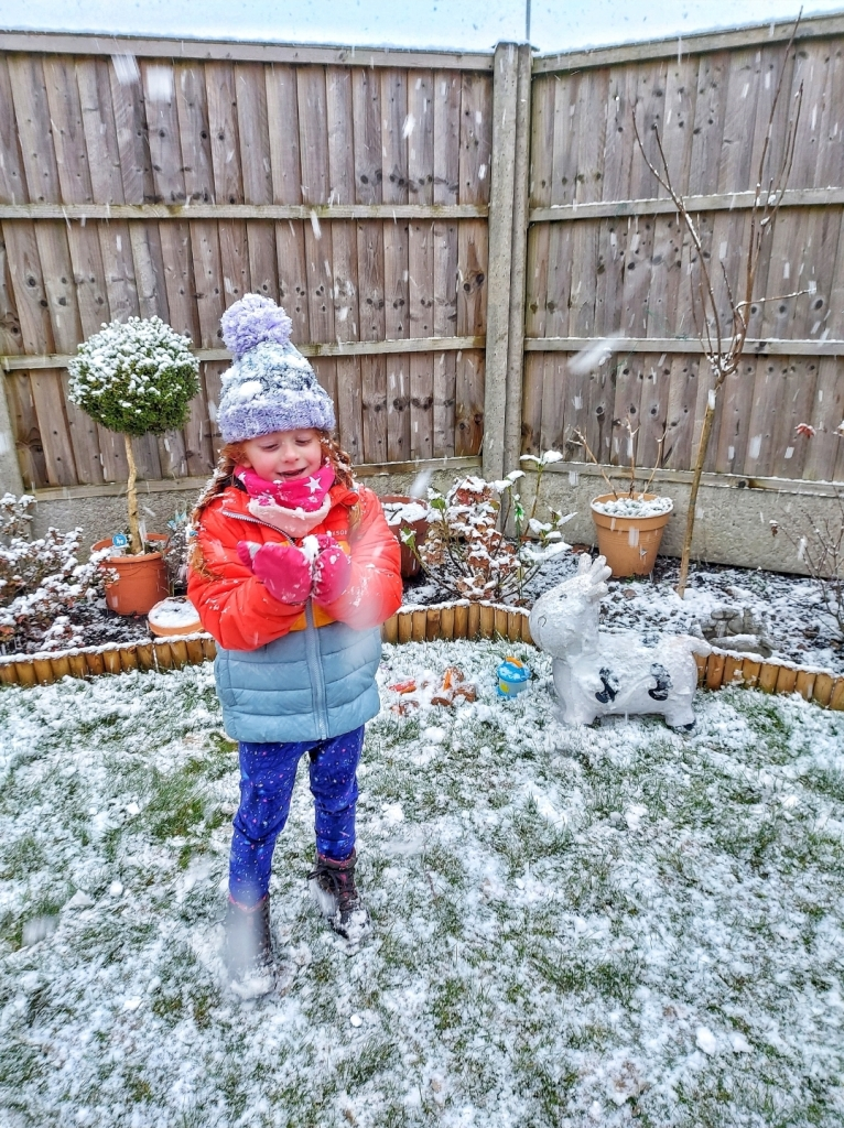 Enjoying the snow in our garden - the layers kept her out there for hours!