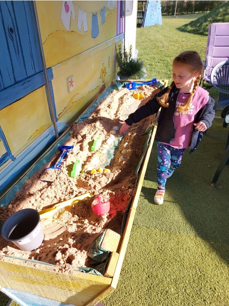 The huge wooden sandpit was a hit with this one!