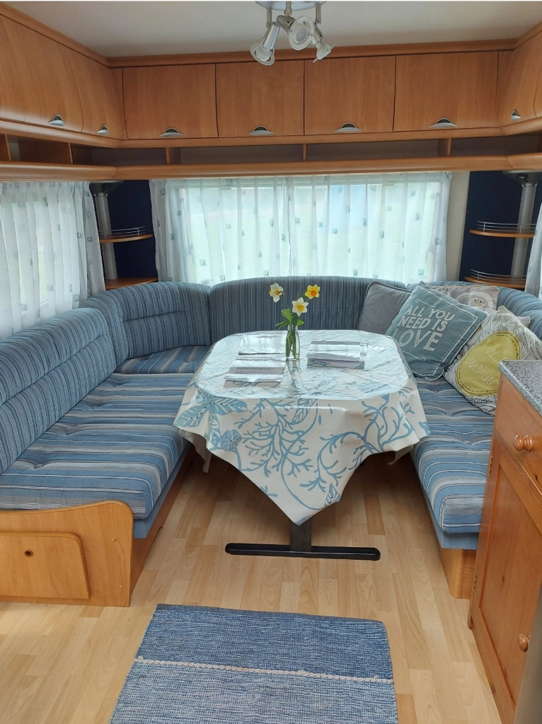 Both caravans have seating areas that convert to beds too