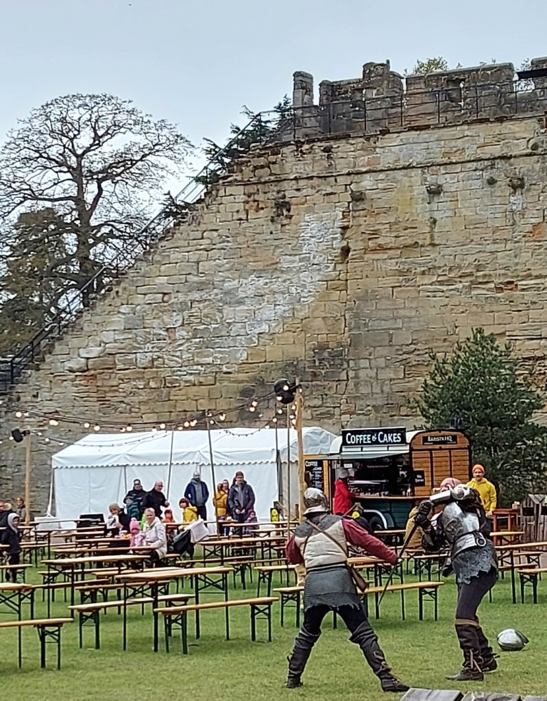 Spontaneous sword fights take place around the grounds throughout the day - here is one by the picnic benches where you can get food and drink