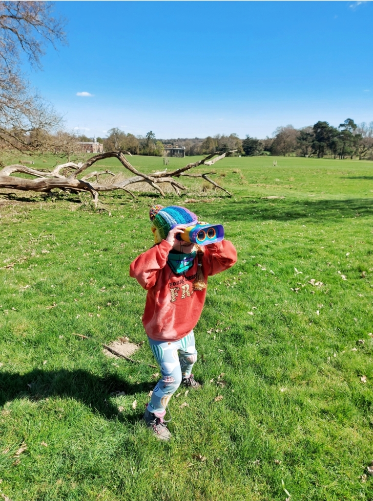 Exploring Calke Abbey with her Learning Resources UK Kidnoculars