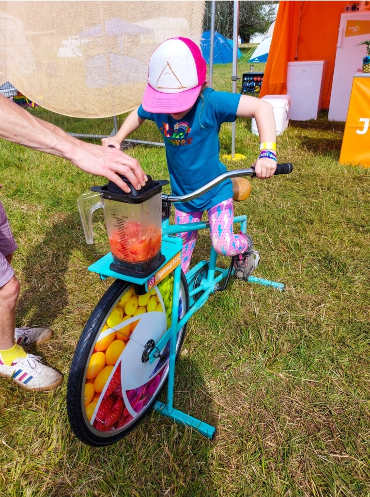 Pedalling to make her own smoothie!