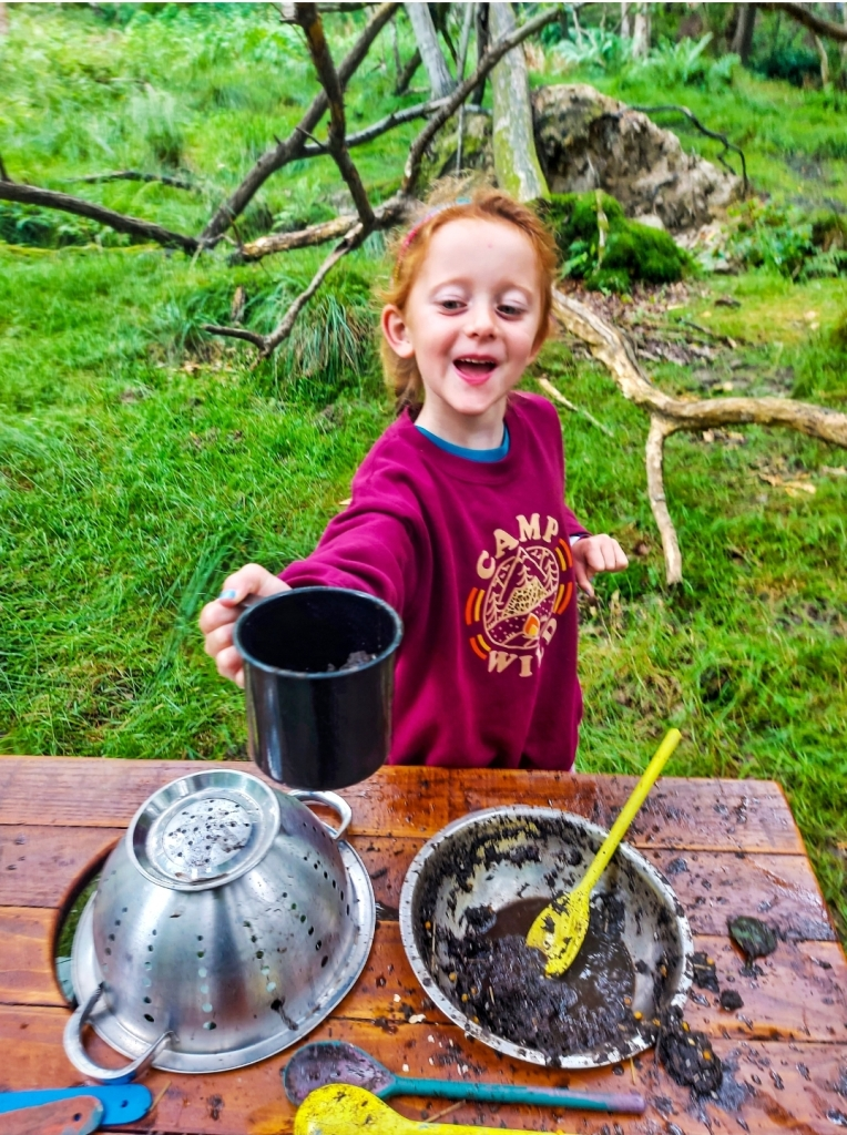 Making me a muduccino in the mud kitchen!