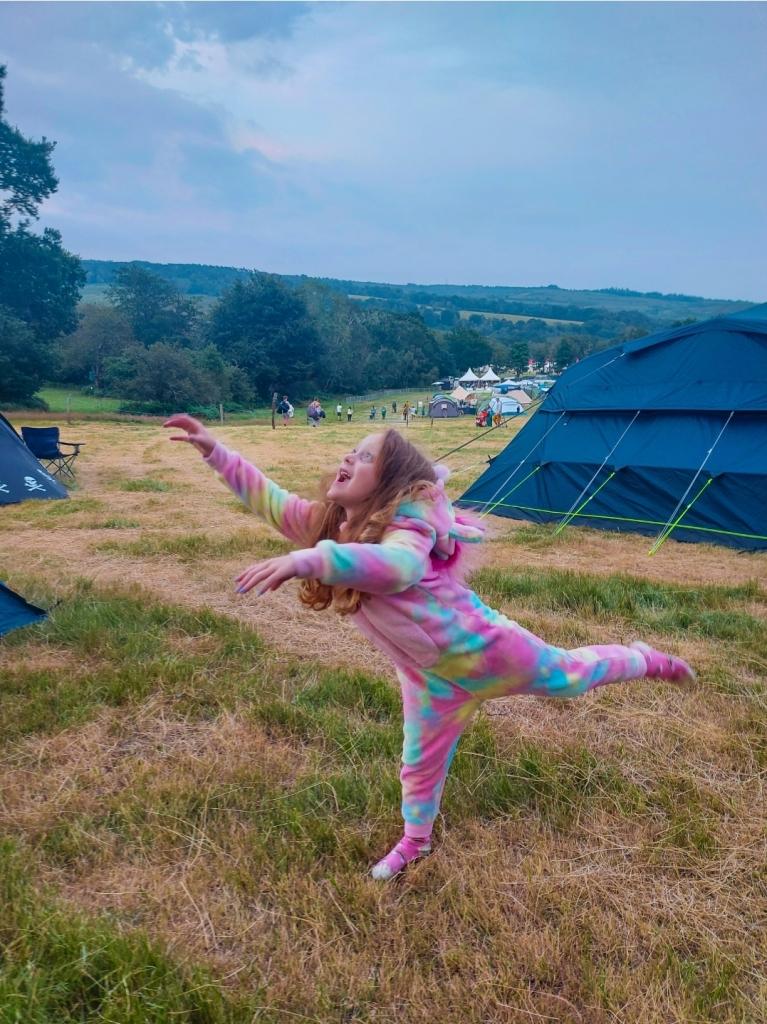 Festival camping in her Kids Onesie