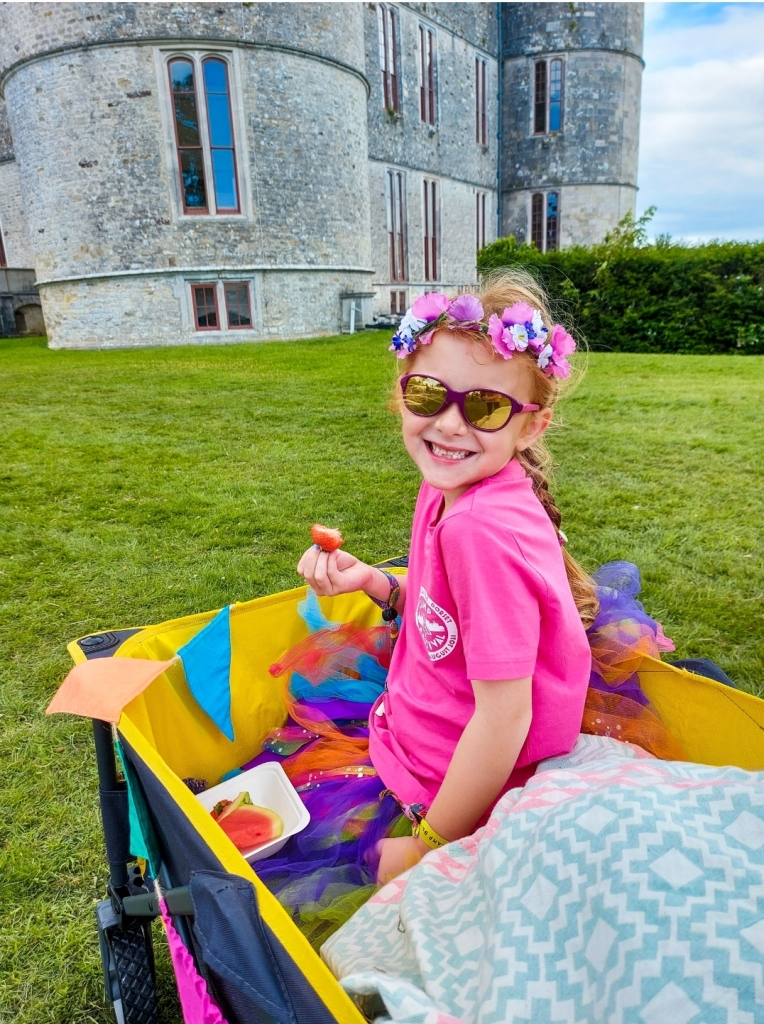 Eating strawberries and melon by Lulworth Castle