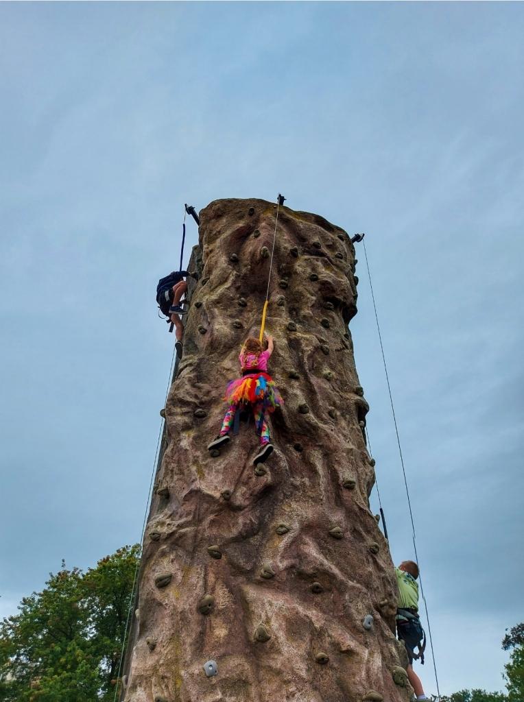 Scrambling up the climbing wall