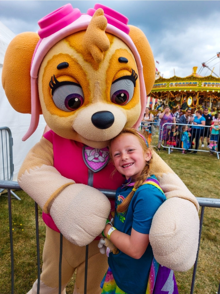 Getting a cuddle from her Paw Patrol favourite, Skye