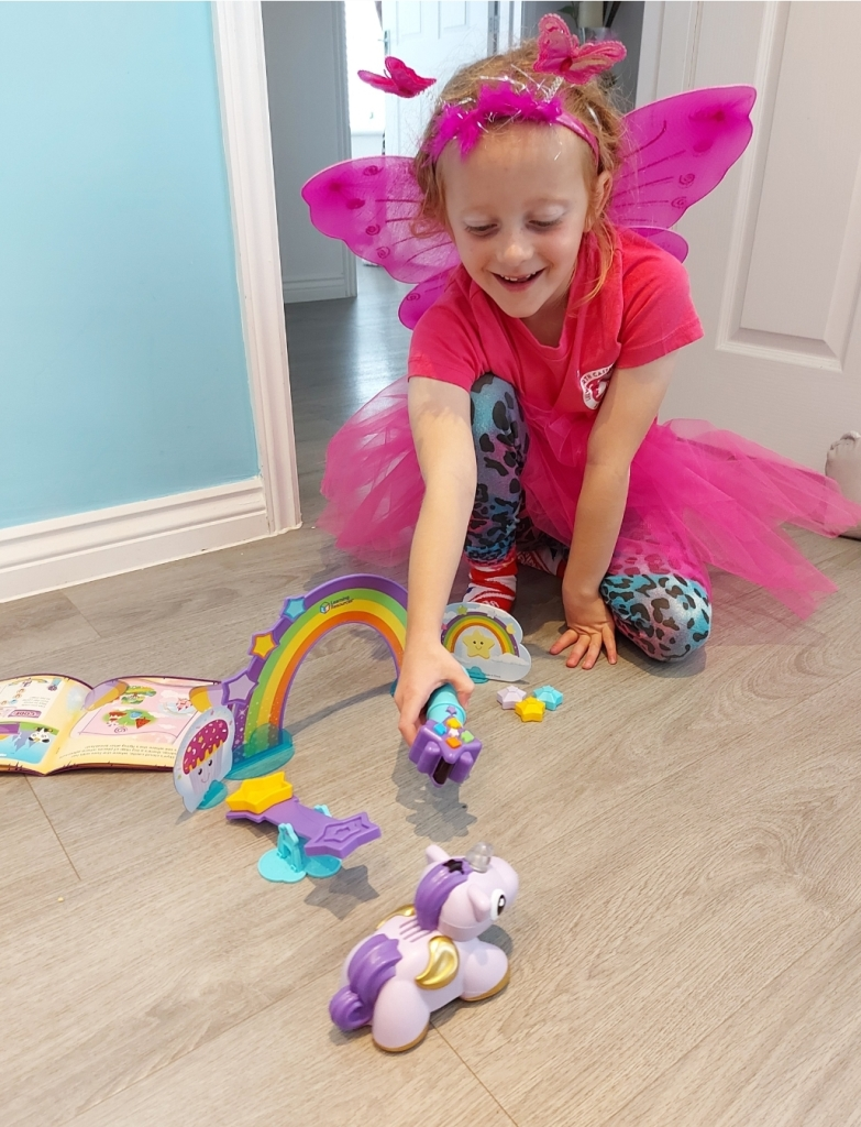 Lily loves controlling her pet unicorn Skye with the magic wand!