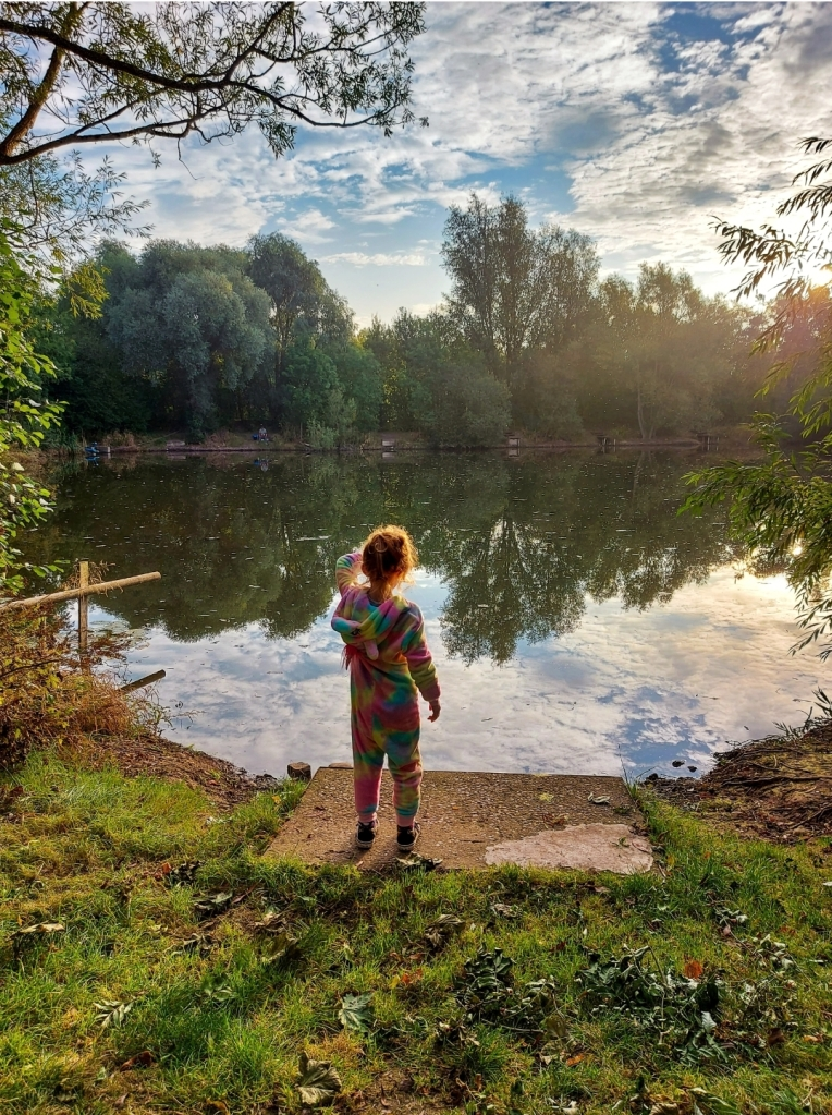 The peaceful fishing lake in the morning in her Kids Onesie!